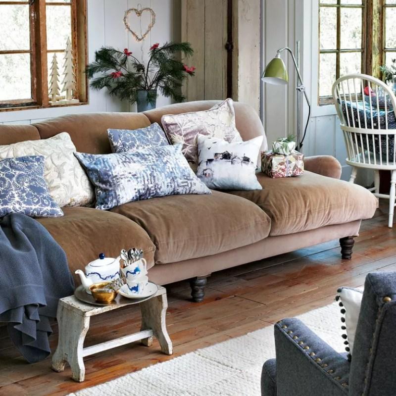 Neutral living room with brown velvet sofa
