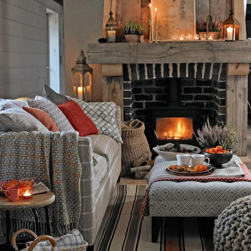 country cottage loving room with cosy layers, log burner and candlelight