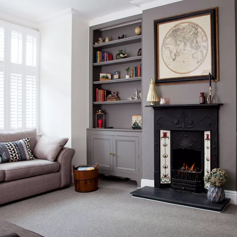 grey and brown living room with original black fireplace