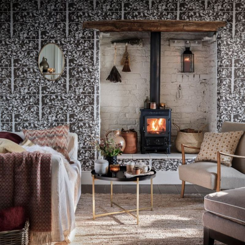 country living room with woodland wallpaper