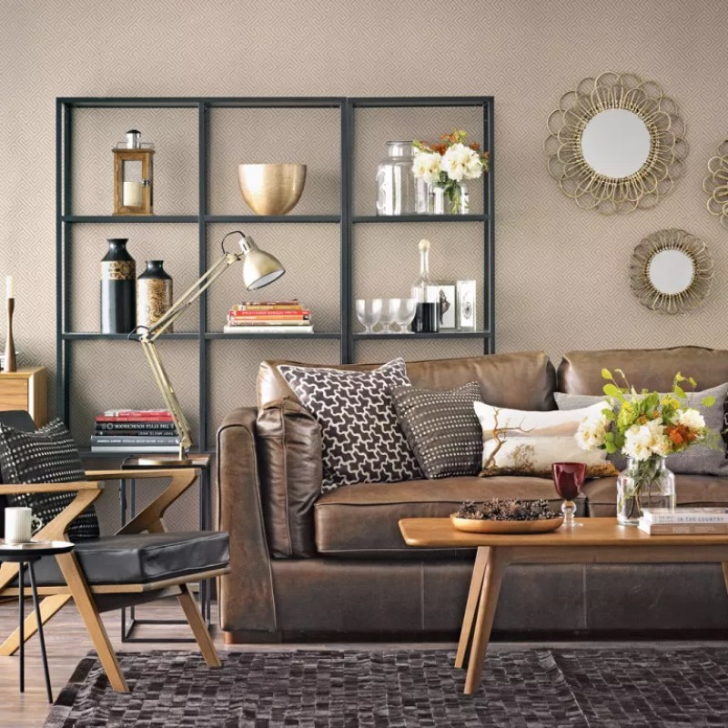 Brown living room with geometric wallpaper and brown leather sofa