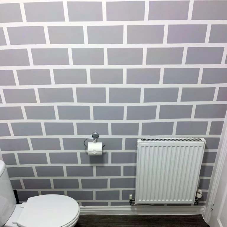 Homeowner paints brick feature wall in her bathroom – using
