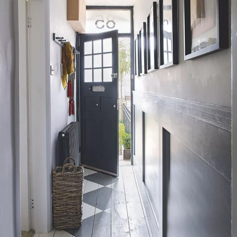 white and grey Narrow hallway with pictures at eye level