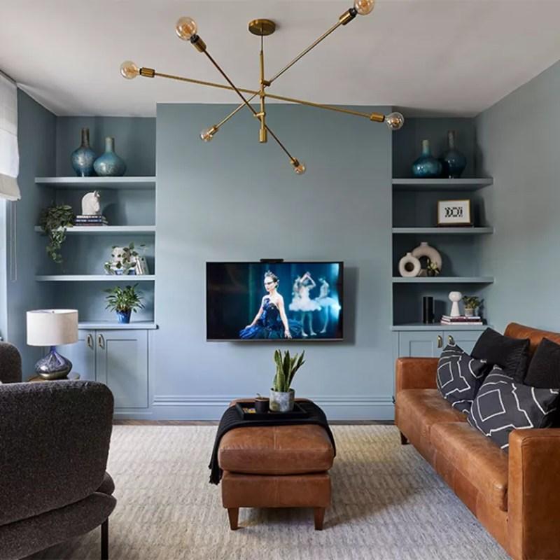 Dusky blue living room with leather sofa