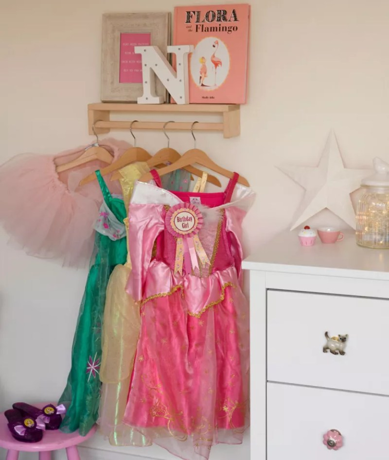 kids room with clothes rail for fancy dress outfits