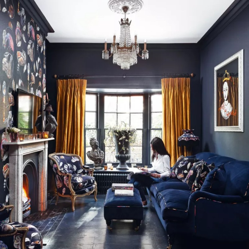 dark blue living room with mustard yellow curtains