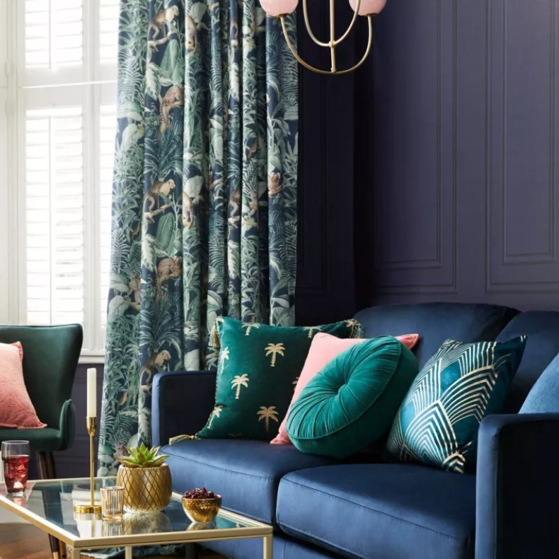 modern deco blue living room with emerald accents