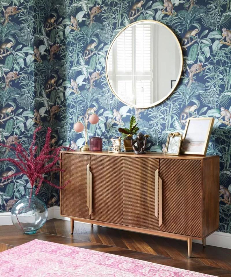 Tropical wallpaper with dar wood sideboard