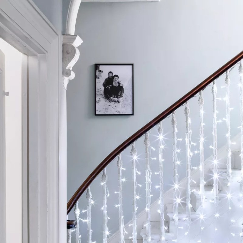 Fairy lights on a banister in a hallway - lights 4 fun
