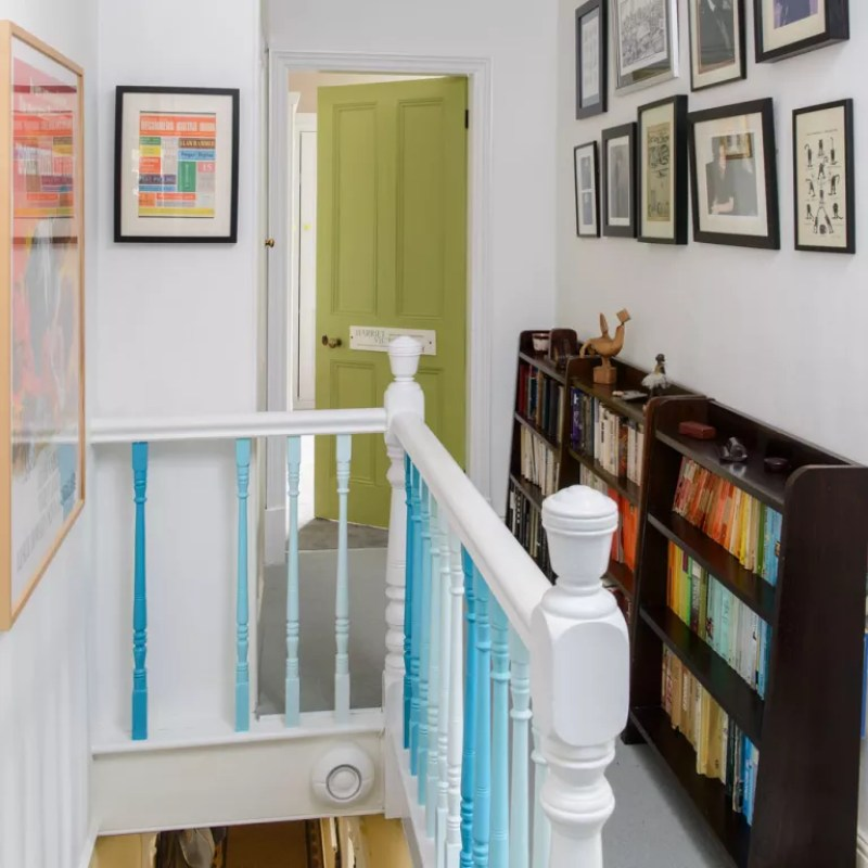 Landing with bookcases and lime green painted door