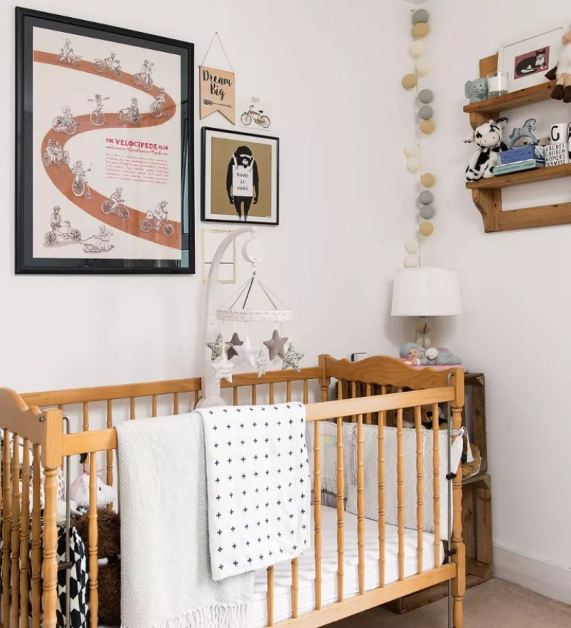 neutral nursery with wooden cot