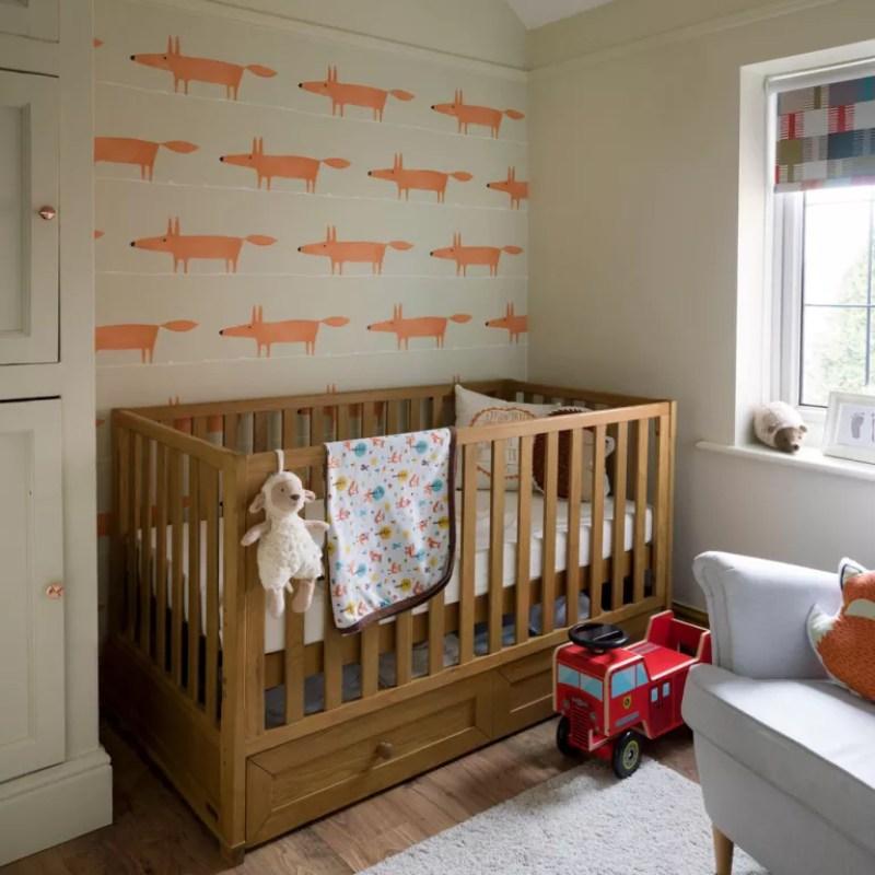 Neutral nursery with fox print wallpaper