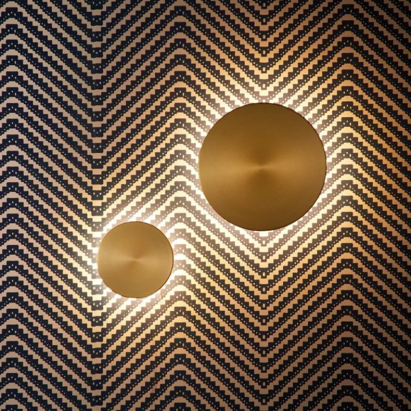 gold wall lights on wallpaper - pooky