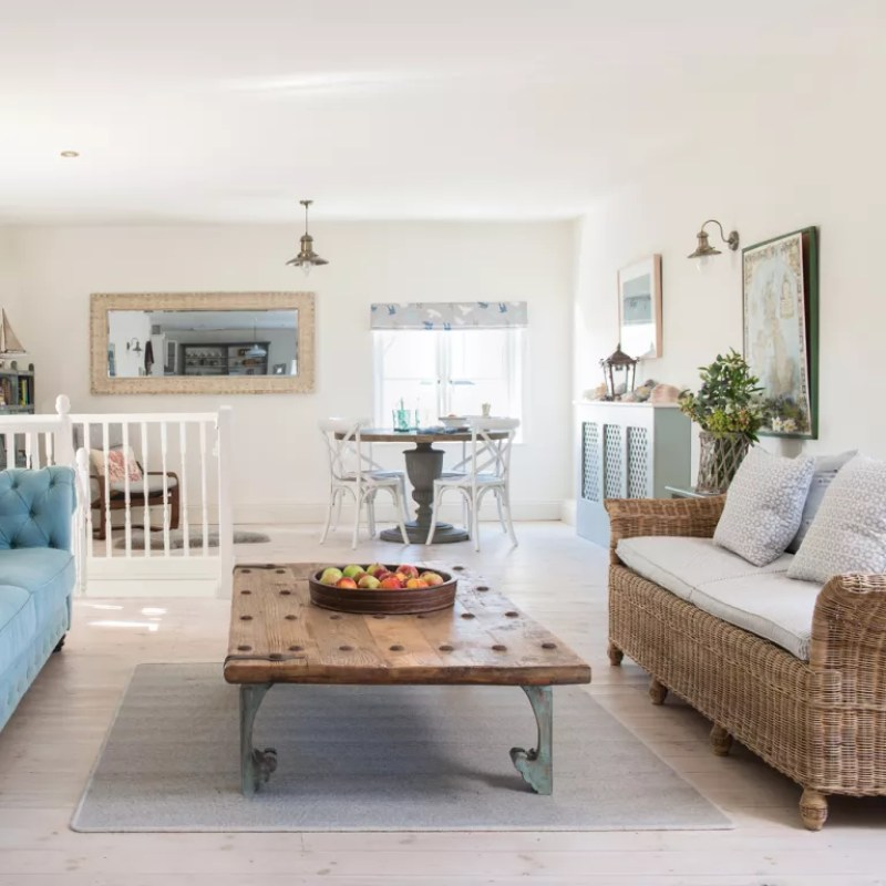 rattan sofa in a country style living room - Colin Poole