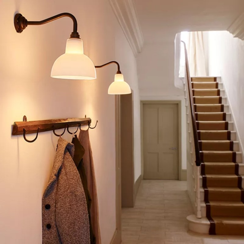 stairway lighting white hallway with striped stair runner and wall lights