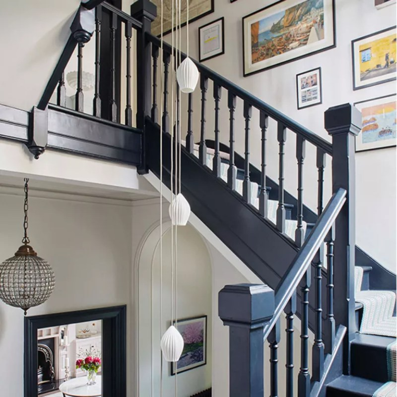 stairway lighting black staircase with droplet pendant light