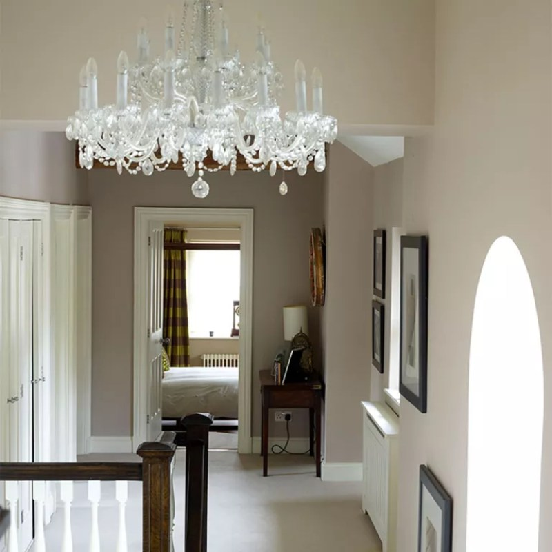 stairway lighting neutral landing with glass chandelier