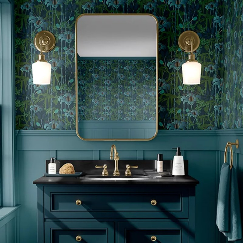 under stairs toilet with green wallpaper and panelling