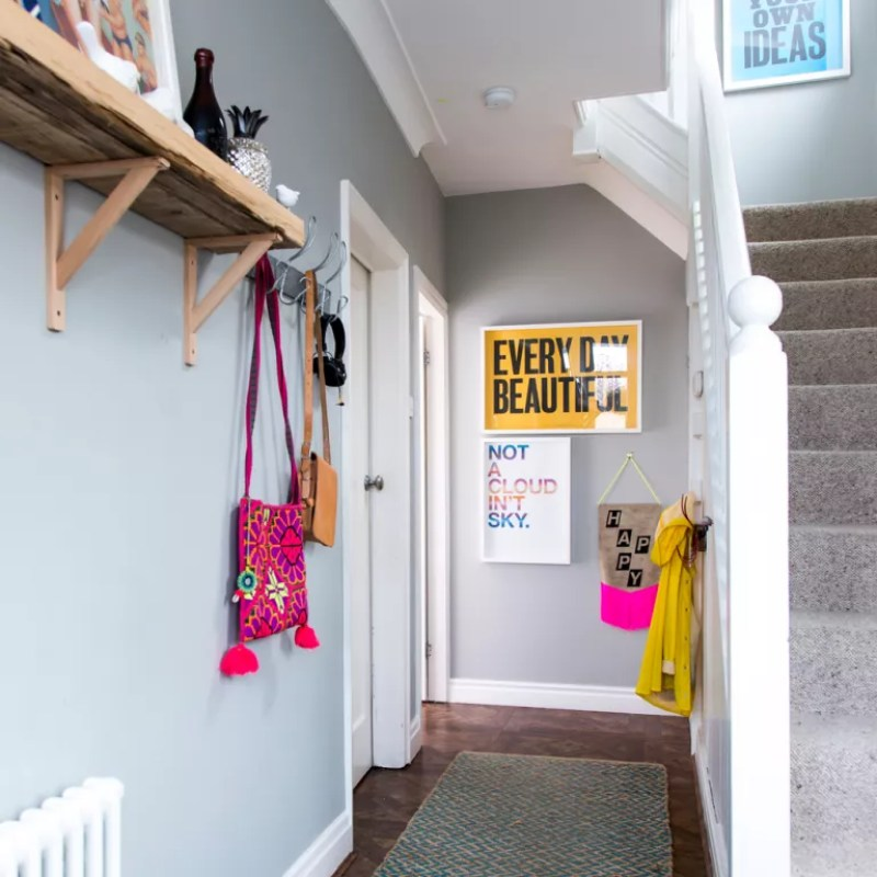 Grey hallway with high shelves and colourful accessories