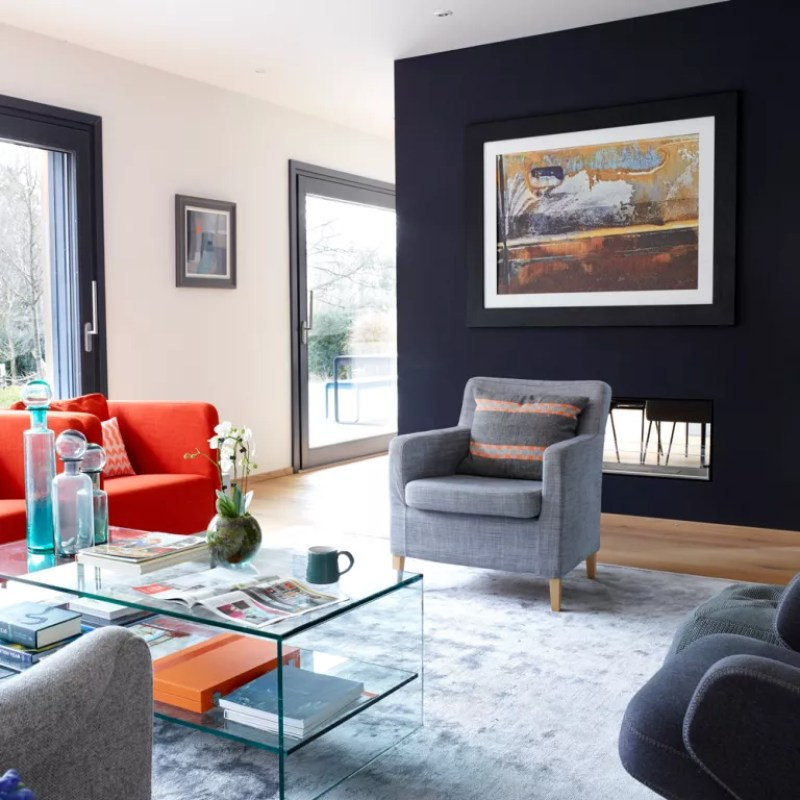 open plan living room with black feature wall with modern fireplace