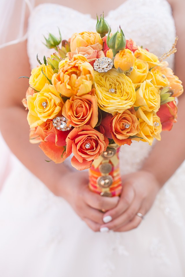 orange and yellow wedding bouquet with jewels.