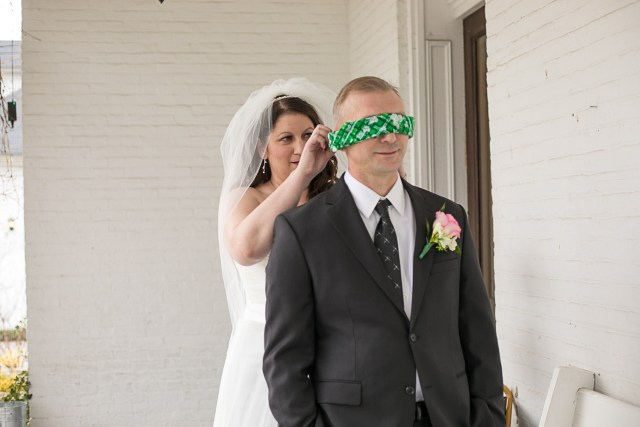 First look, groom blindfolded. Carriage Inn Lane wedding