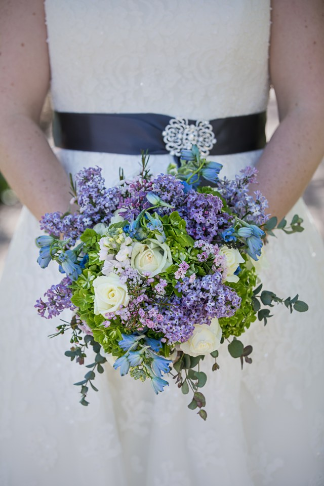 Wedding bouquet with lilacs and white roses