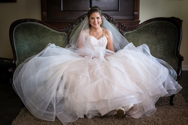 bride sitting on vintage couch