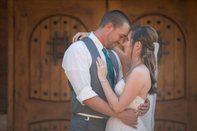 bride and groom infront of wood doors