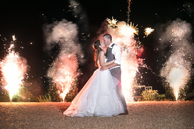 kissing in front of fireworks