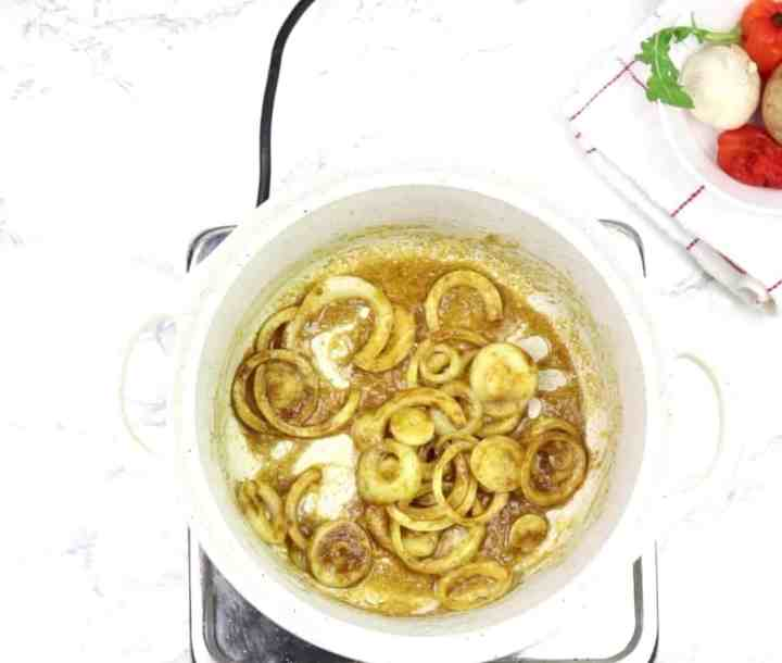 Add curry powder and onion slices