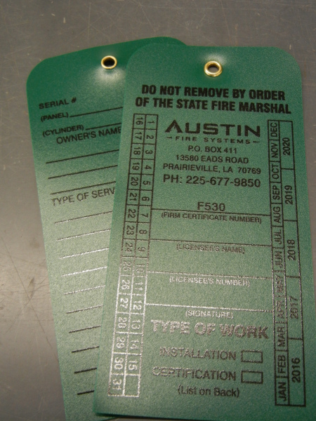 The most popular option for our durable plastic extinguisher tag is a metal eyelet.