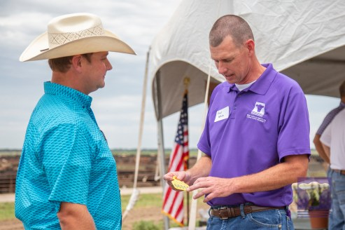 Dr. White explains the official tags to a producer stakeholder.