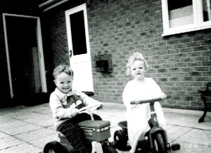 charl and haydn on trikes at grandmas copy black and white