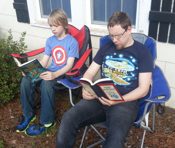 Me and the boy, reading our Pratchett