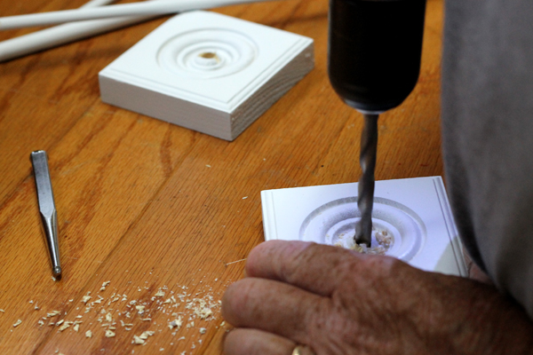 Drill a hole into the medallion