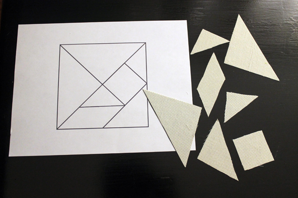 Tangram pattern and fabric covered magnets