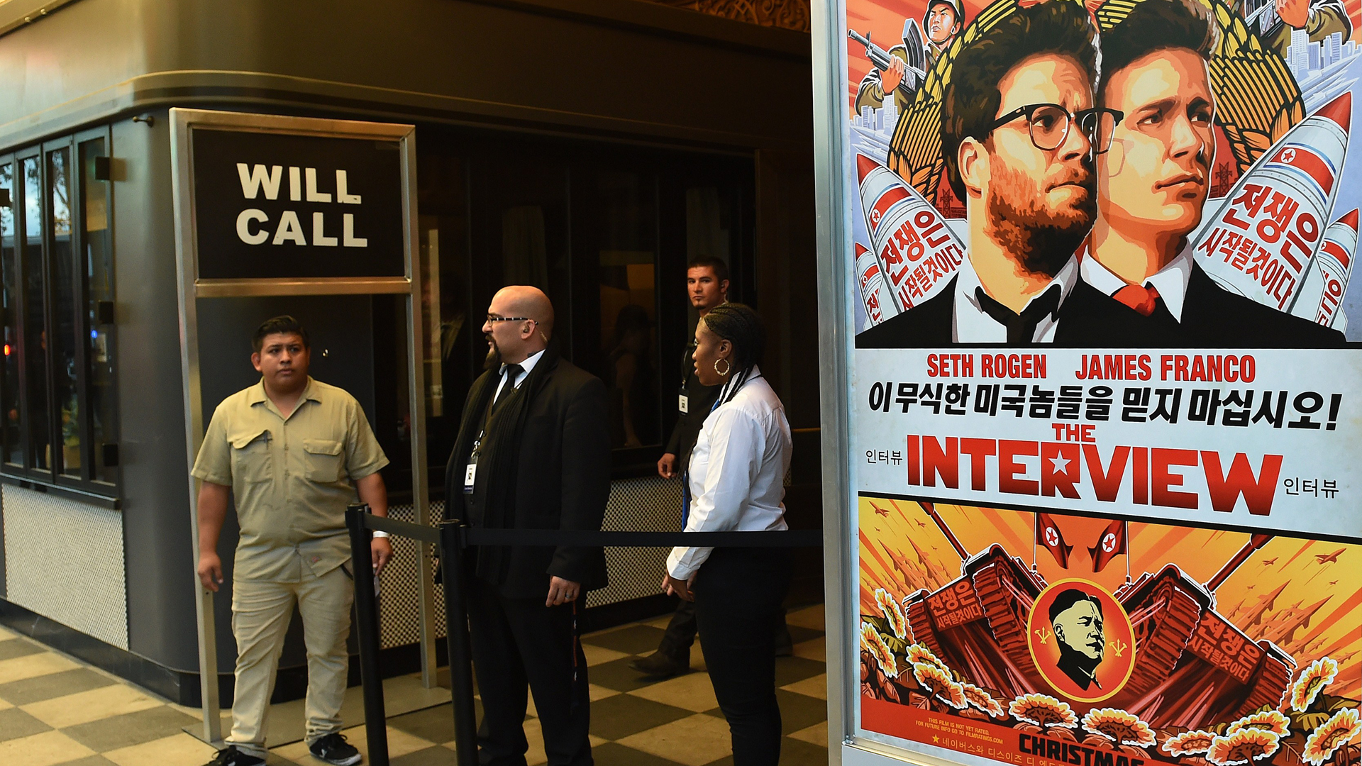 Security is seen outside The Theatre at Ace Hotel before the premiere of the film 'The Interview' in Los Angeles on Dec. 11, 2014. (Credit: AFP/Getty Images)