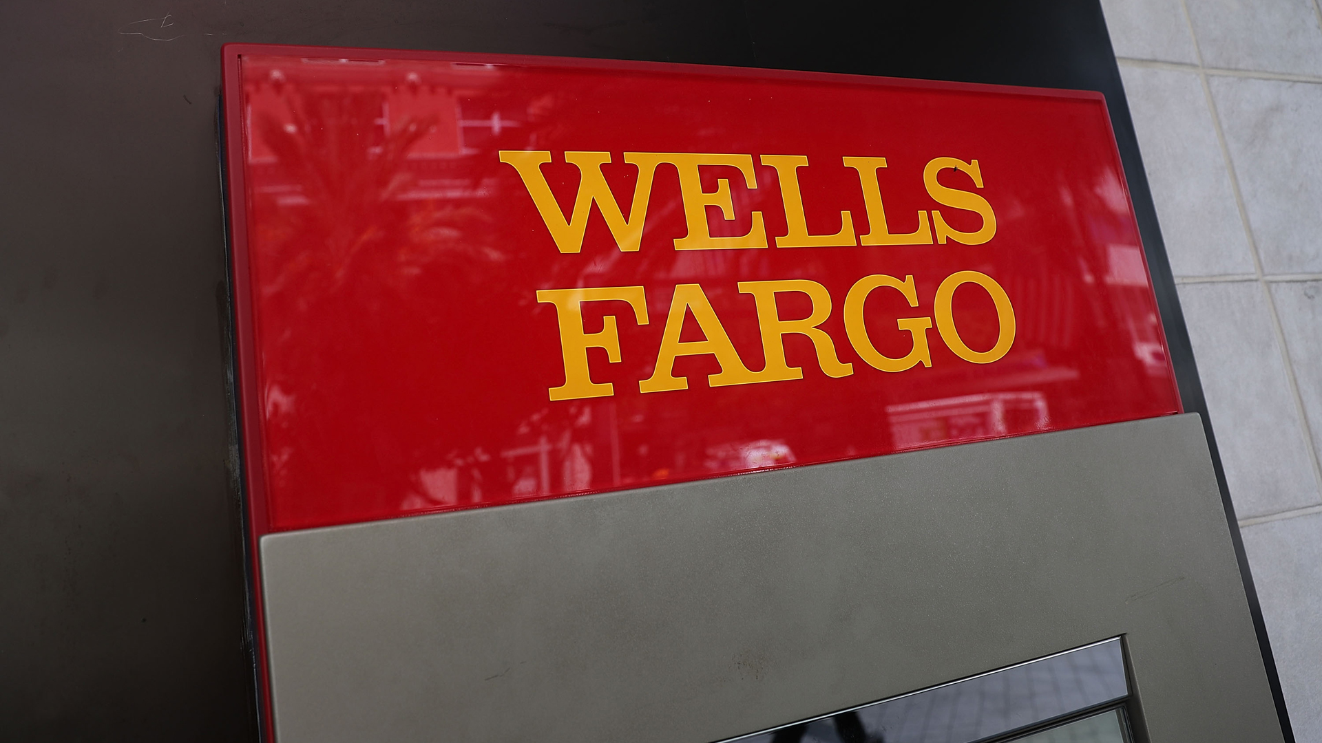 A sign is seen on a Wells Fargo ATM at one of their bank branches on Sept. 9, 2016 in Miami. (Credit: Joe Raedle/Getty Images)