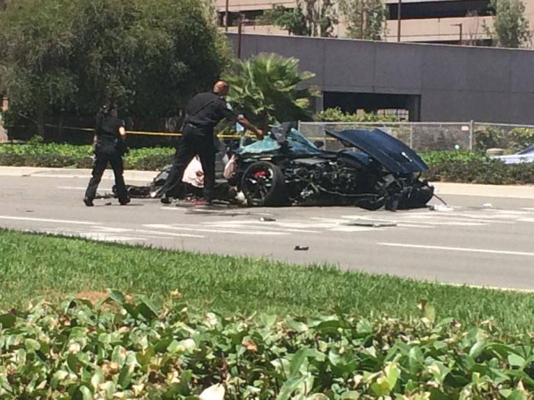 A Corvette was left mangled after a crash in Irvine that killed two women and critically injured a man on July 22, 2017. (Credit: Orange County Register)