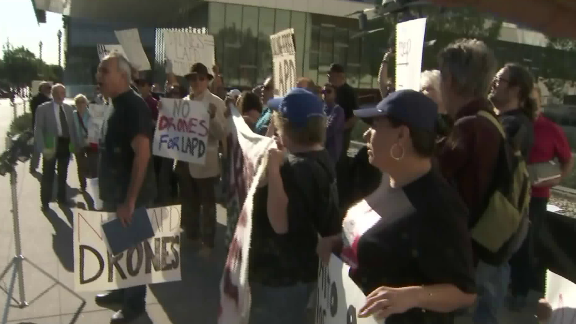 Protestors rally outside a meeting about the Los Angeles Police Department's use of drones on Feb. 7, 2018. (Credit: KTLA)