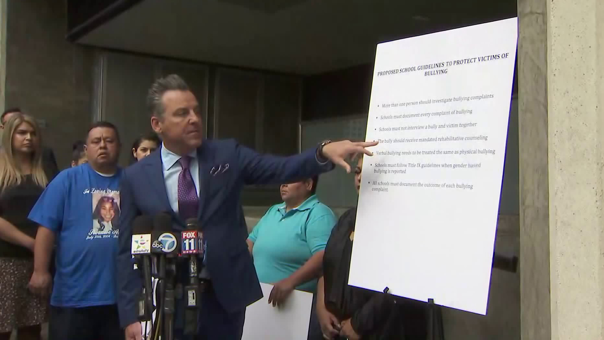 Brian Claypool speaks alongside families he is representing in bullying cases against school districts on May 15, 2018. (Credit: KTLA)
