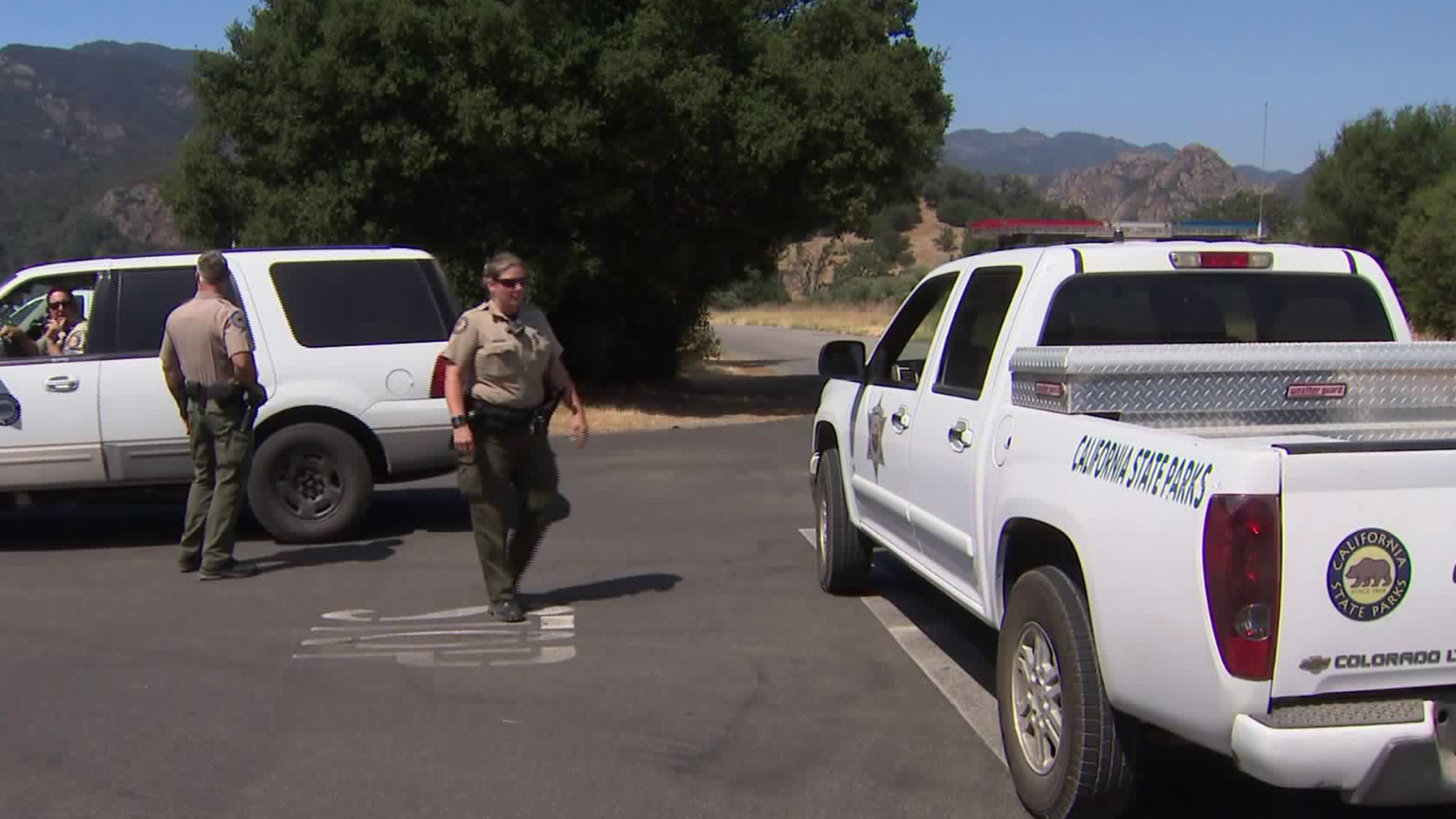 Officers investigate the shooting death of a man at the Malibu Creek State Park in Calabasas on June 22, 2018. (Credit: KTLA)