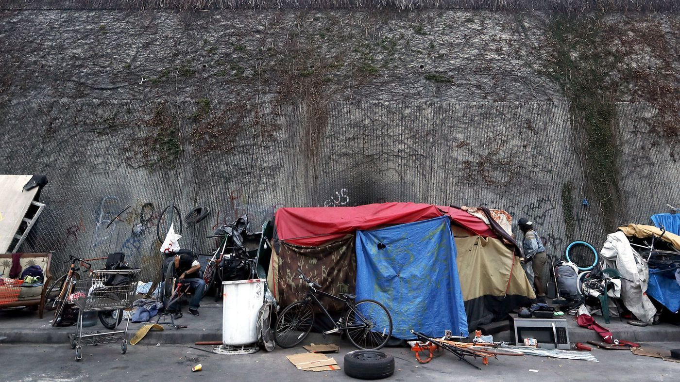 A homeless encampment is seen along Grand Avenue in South Los Angeles in this undated photo. (Credit: Luis Sinco / Los Angeles Times)
