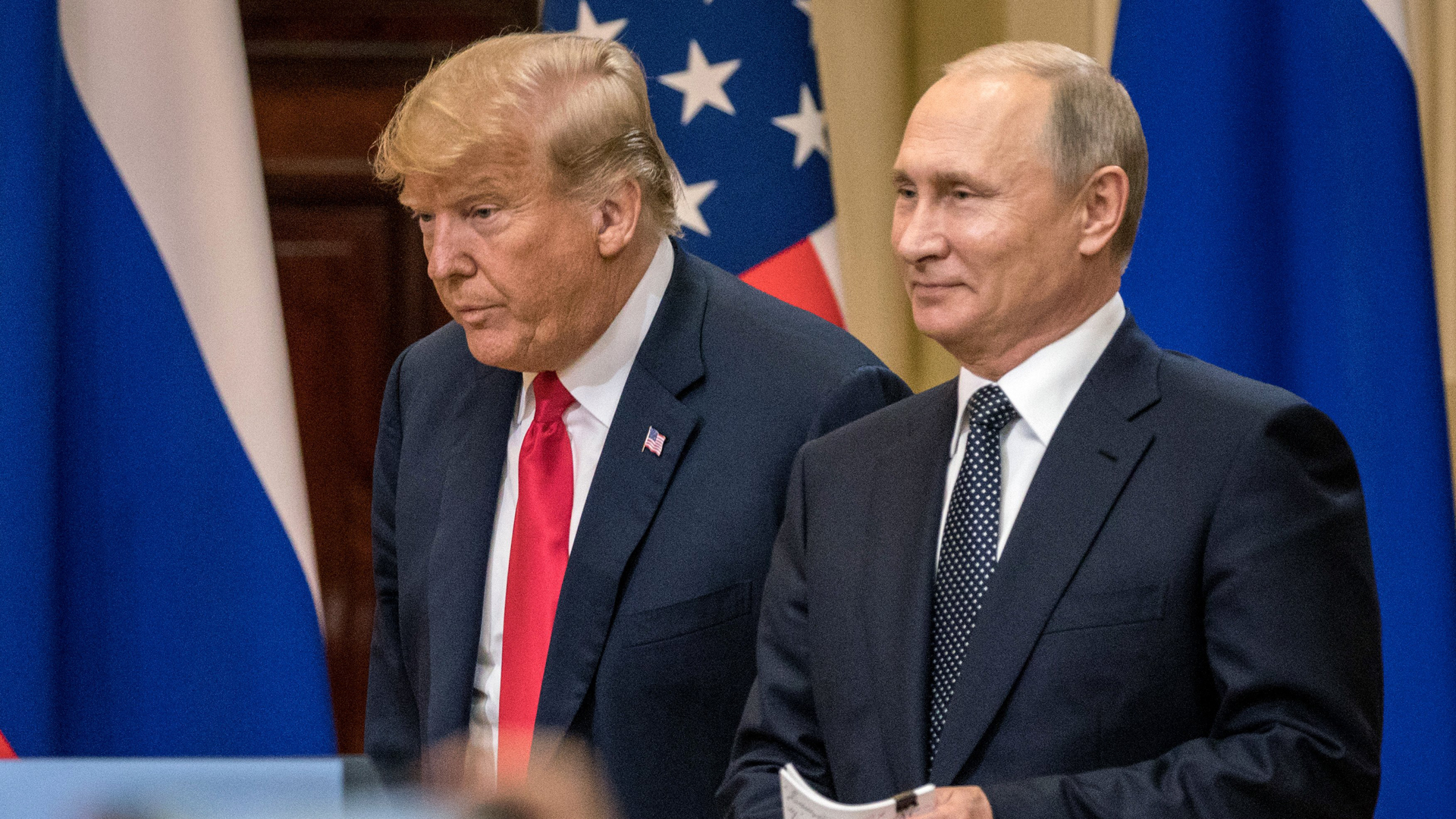President Donald Trump and Russian President Vladimir Putin arrive to waiting media during a joint press conference after their summit on July 16, 2018, in Helsinki, Finland. (Credit: Chris McGrath/Getty Images)