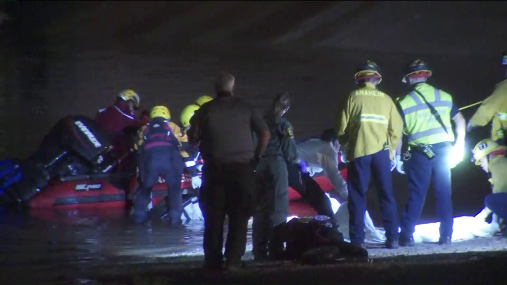 Authorities investigate the death of a man whose body was found in an Anaheim flood channel on Sept. 4, 2018. (Credit: KTLA)