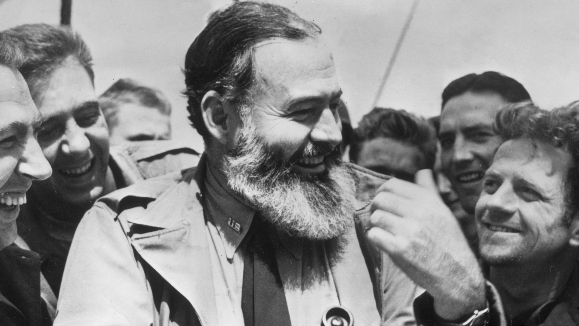 Ernest Hemingway is seen travelling with U.S. soldiers, in his capacity as war correspondent, on their way to Normandy for the D-Day landings. (Credit: Central Press/Getty Images)