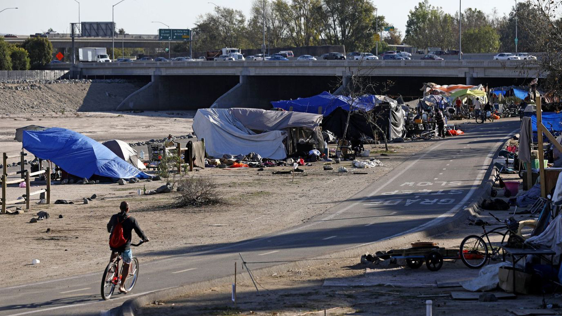 A homeless encampment along the Santa Ana River in Anaheim. Earlier this year, a federal judge ordered the encampment to be cleared. (Credit: Gary Coronado / Los Angeles Times)