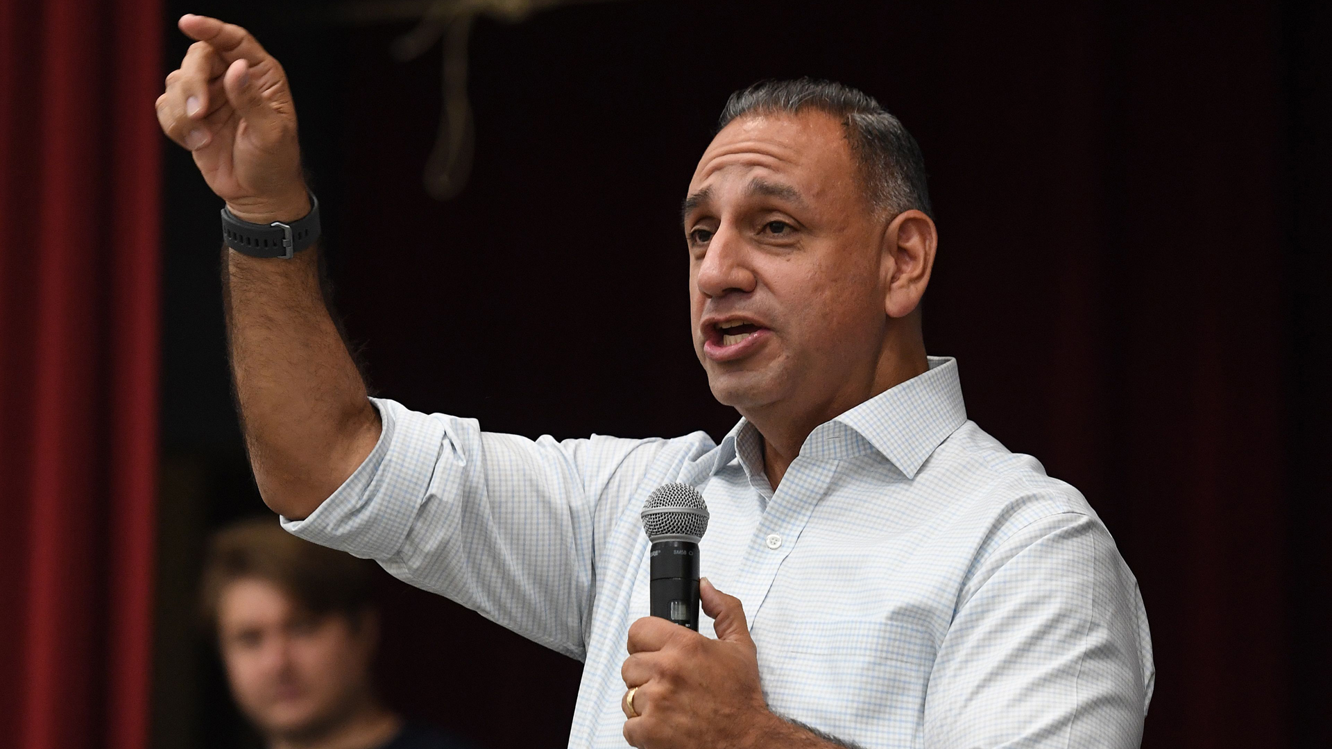 Gil Cisneros campaign in Buena Park to represent California's 39th congressional district during the 2018 mid-term elections on Nov. 5, 2018. (Credit: MARK RALSTON/AFP/Getty Images)