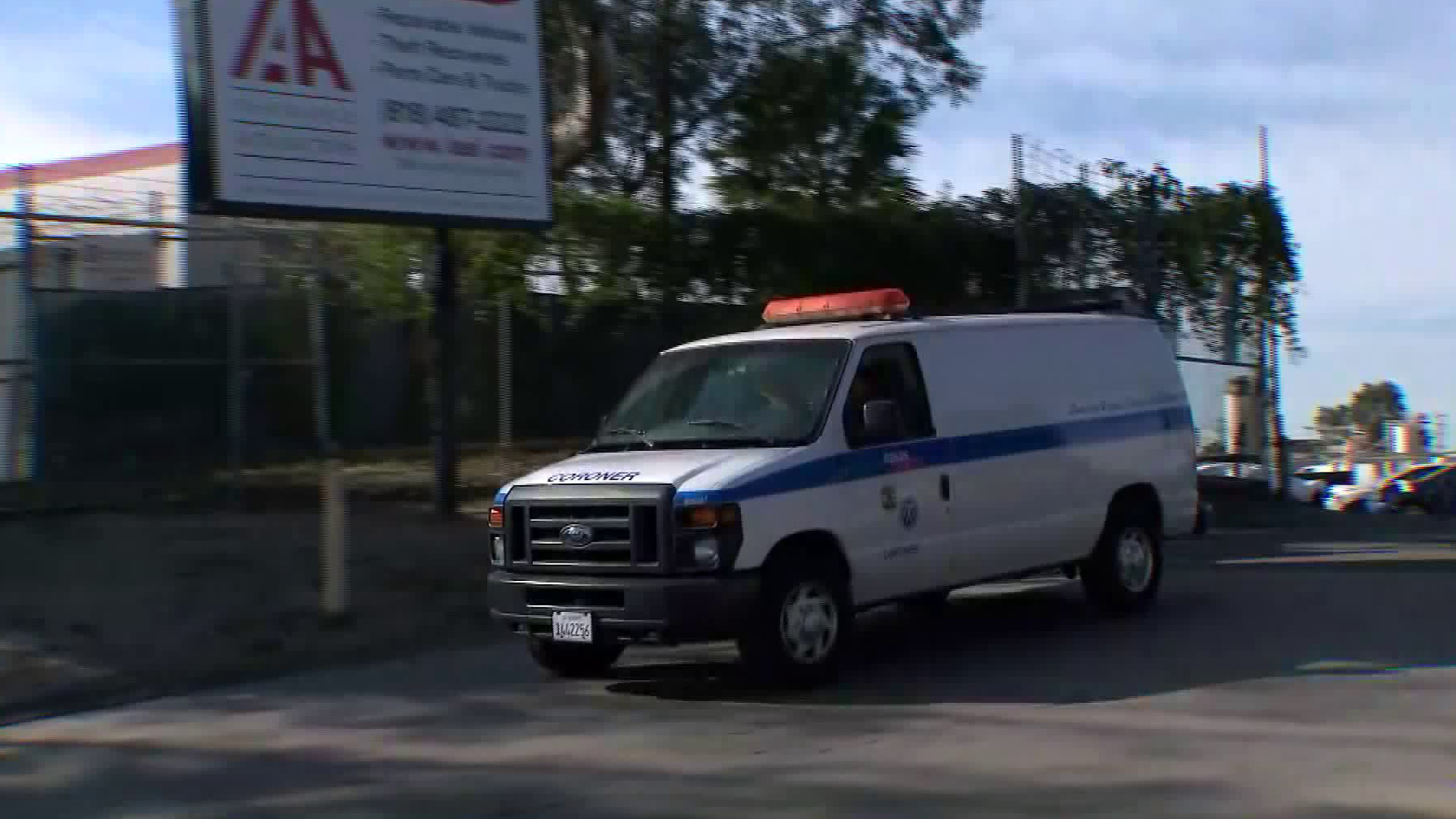 A coroner van leaves a business in Sun Valley after a worker was fatally crushed on Dec. 31, 2018. (Credit: KTLA)